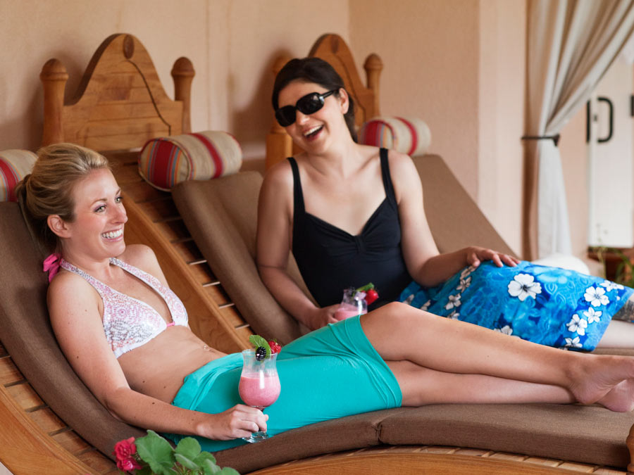 Two women lounge by the pool at the Fairmont Sonoma Mission Inn & Spa, Sonoma County