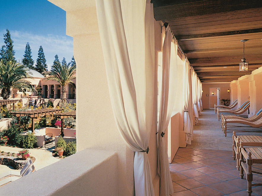 A hallway on the balcony of Fairmont Sonoma Mission Inn and Spa reveals the spa below