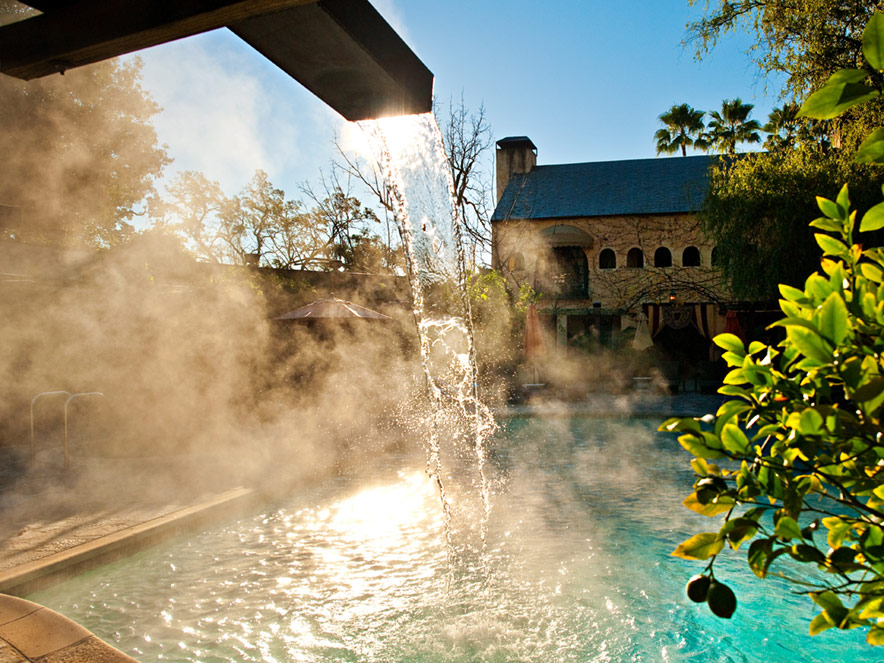 A water fountain of hot water pours into the spa at Kenwood Inn and Spa