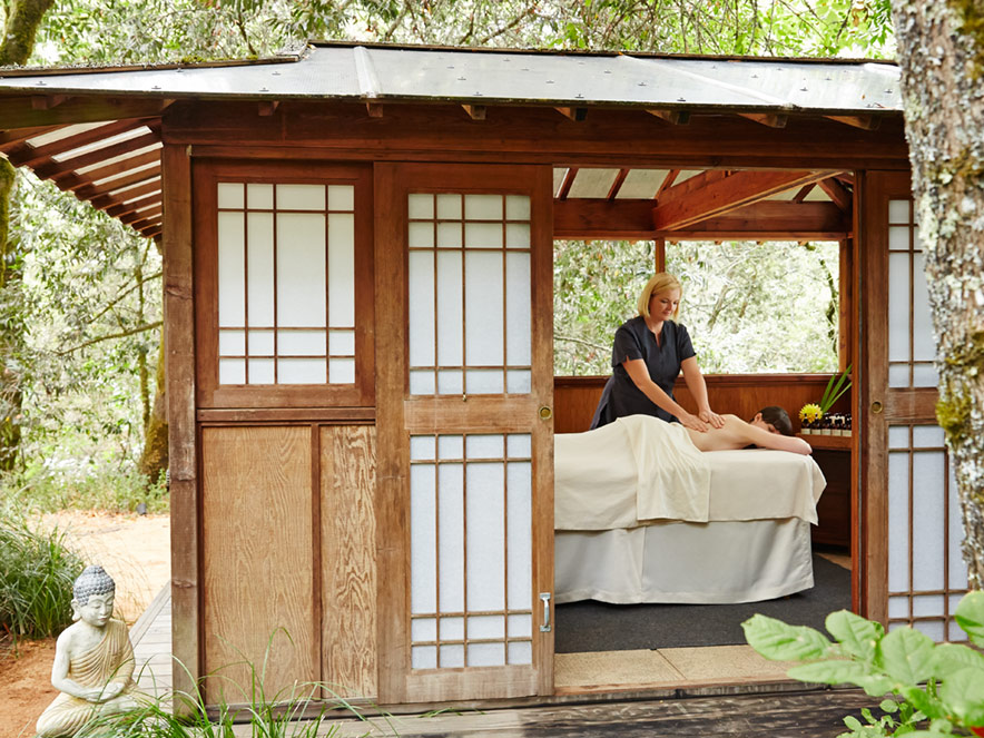 A masseuse works on a client in a Japanese-style paper-and-wood hut in the middle of a forest at Osmosis Day Spa, Sonoma County, California