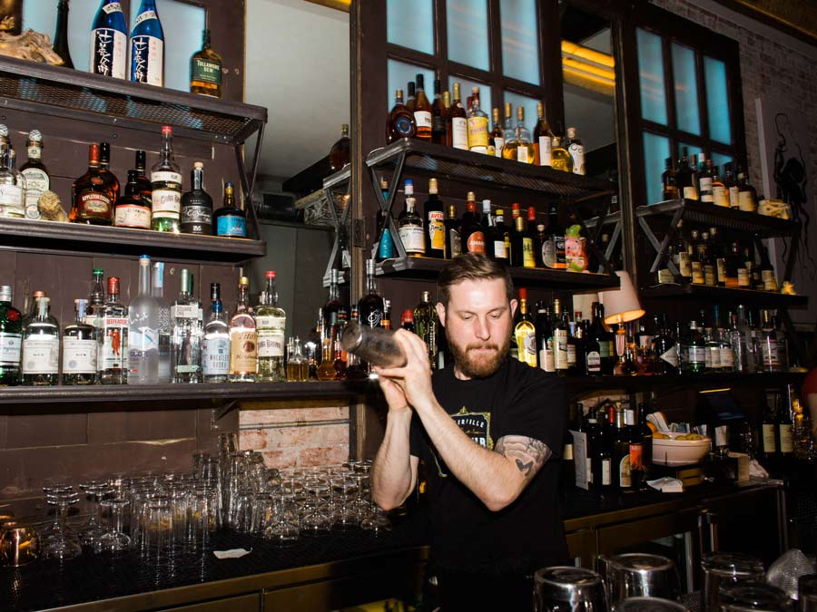 A bartender shakes a cocktail at the Geyserville Gun Club Bar & Lounge, Sonoma County