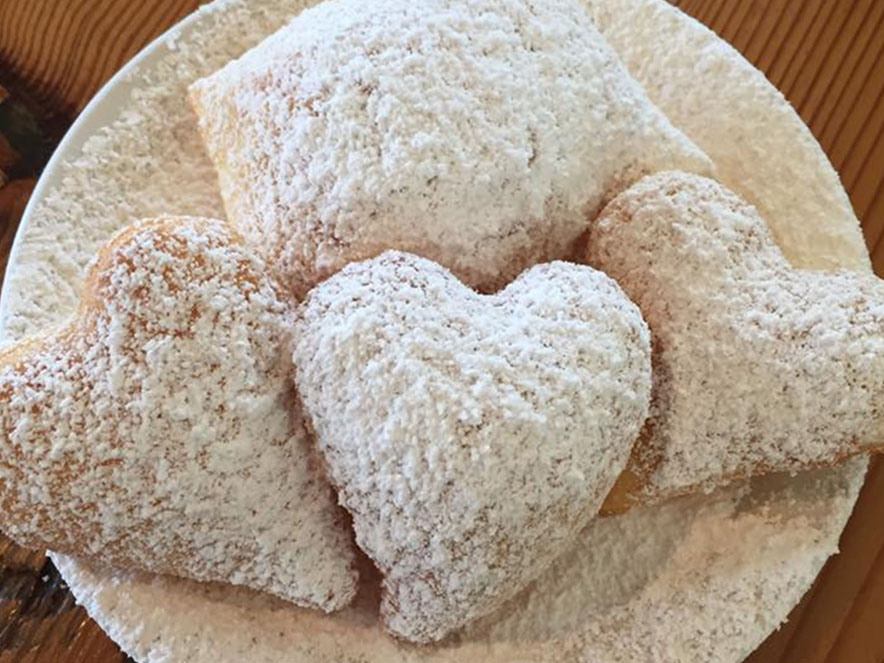 Beignets from the Parish Cafe are covered in powdered sugar in Sonoma County.