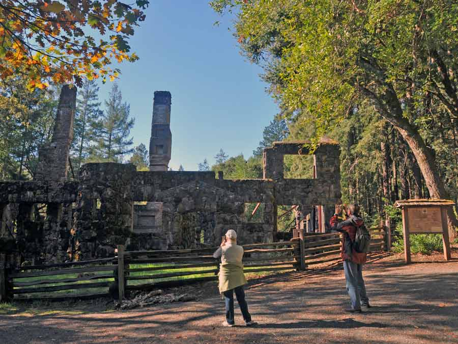 Guests take photos of the Wolf House ruins at Jack London State Historic Park, Glen Ellen