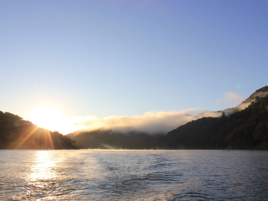 Image of the water of Lake Sonoma with a little fog on it in Sonoma County