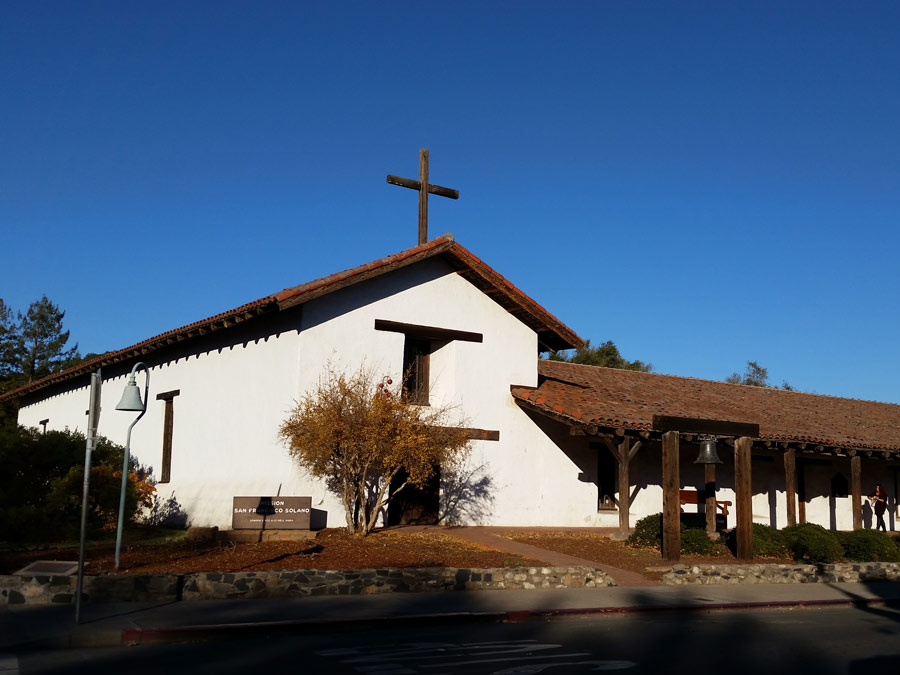 The facade of the original mission in front of bright blue sky at the Sonoma State Historic Park in Sonoma County