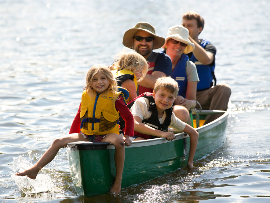 adults and children on a boat in Spring Lake in Sonoma County