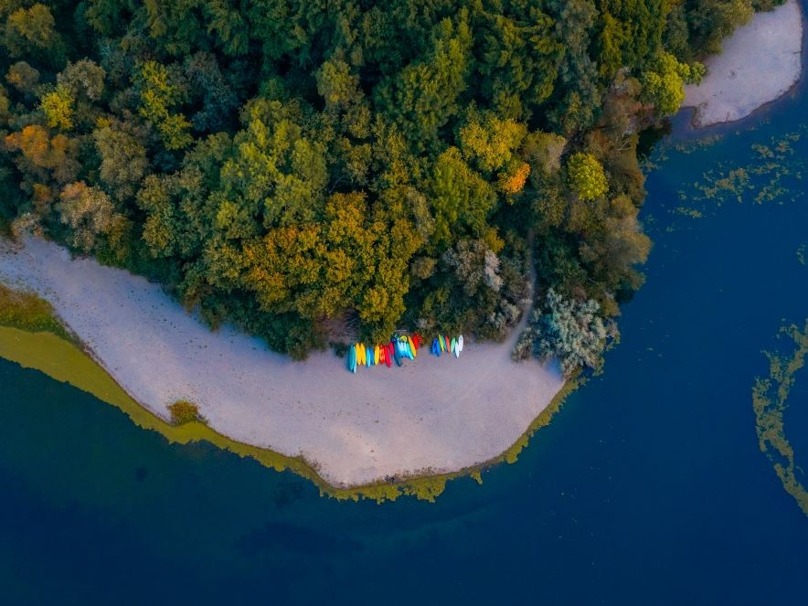 Picture of kayaks on river shore
