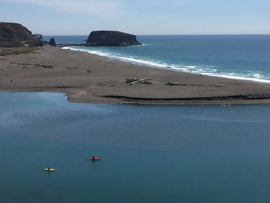 People kayak where the Russian River meets the Pacific Ocean at Jenner, Sonoma County