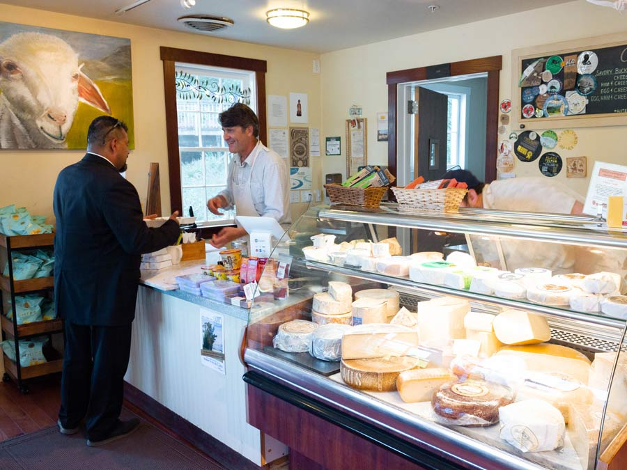 A man selects cheese at the Freestone Artisan Cheese shop, Sonoma County