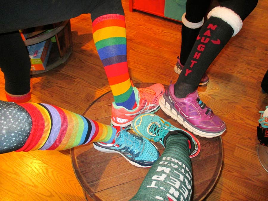 Runners show off their fun socks after a trail run in Sonoma County