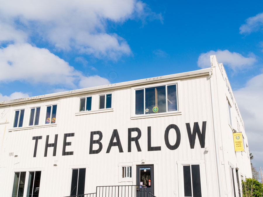 "A warehouse has a big sign on the side that reads ""The Barlow"" in Sebastopol, Sonoma County"