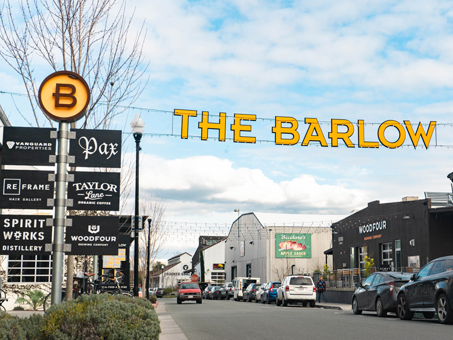 "A letter banner spelling out ""The Barlow"" Hands over the entrance to the open air marketplace in Sebastopol, Sonoma County, California"