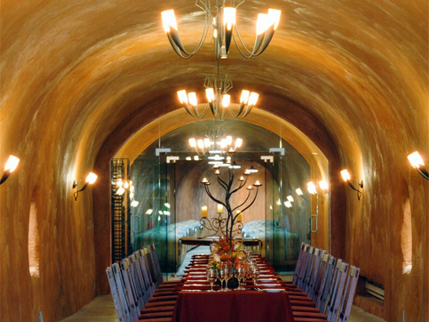 A table is set for a luxurious dinner in the cave at Benziger Family Winery, Glen Ellen