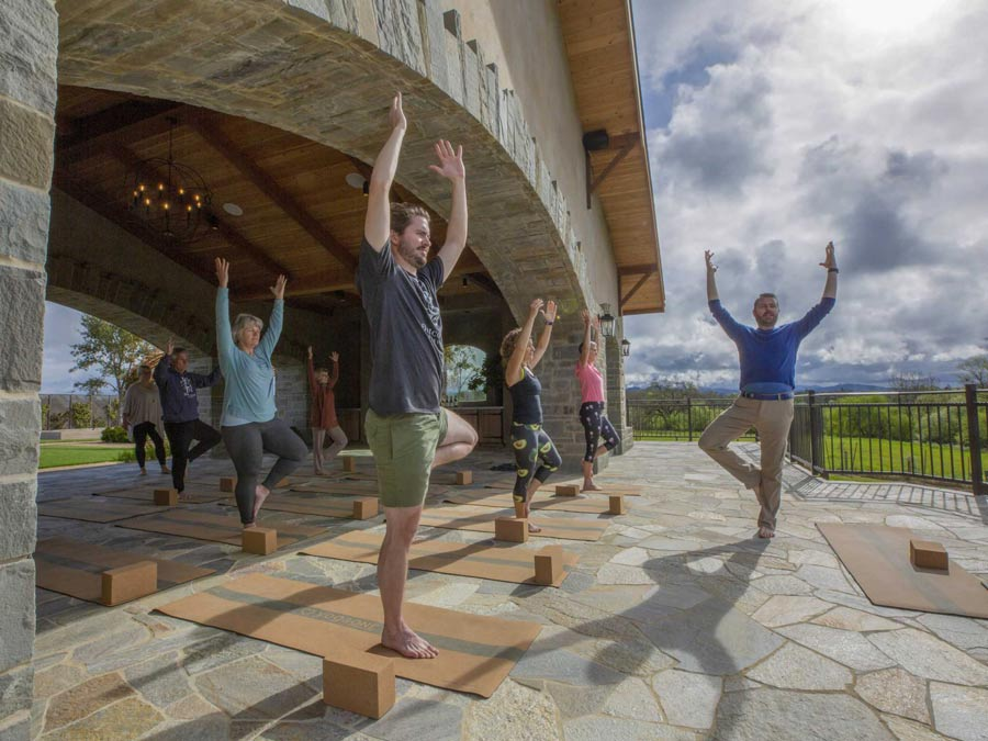People practice yoga at a winery