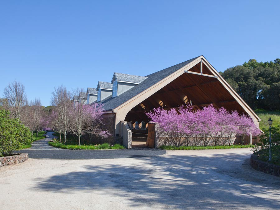 The horse pavilion at Chalk Hill is flanked by blooming trees in Sonoma County