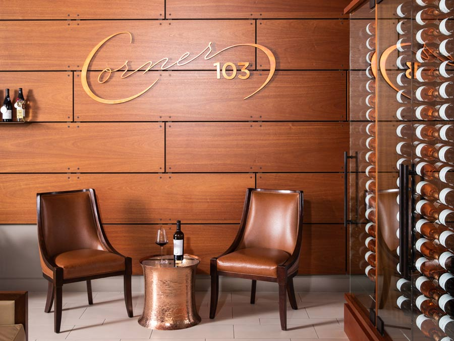 Brown leather chairs in front of a wood tiled wall in the tasting room