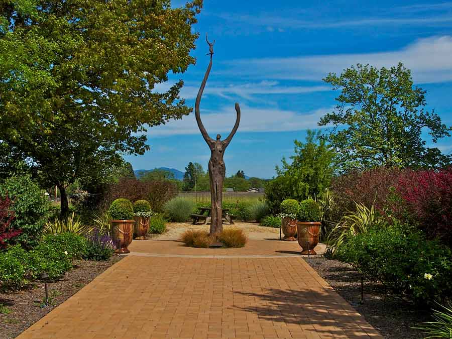 The 18-foot tall bronze statue of Gaia greets visitors to DeLoach Vineyards
