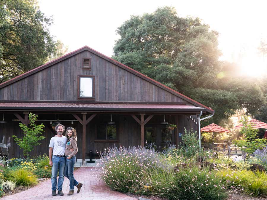 Owners Suzanne Hagins and Chris Condos stand outside of the tasting barn at Horse & Plow, Sebastopol