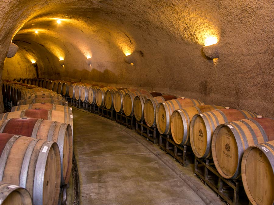 Barrels are lined up in a cave at Keller Estate Winery, Sonoma County