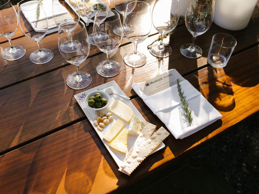 A table set with wine glasses and a cheese pairing
