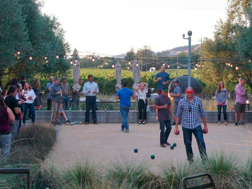 People play bocce at dusk at the rustic Medlock Ames Tasting Room, Healdsburg