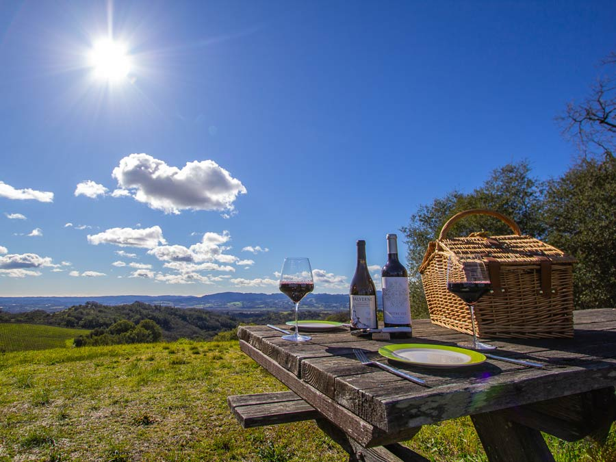 A table overlooking the valley is set for a wine tasting in Sonoma County
