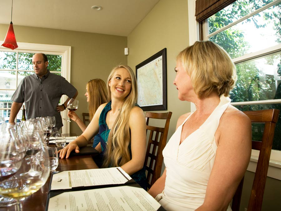 Guests are ready for a wine tasting sitting at a table