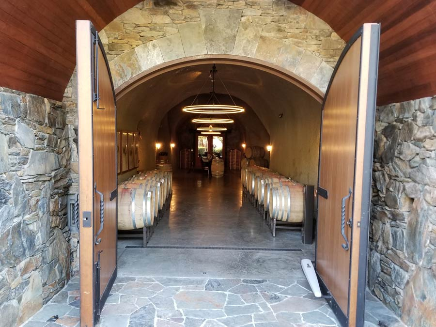 Two big doors open to the entrance of the cave at Thomas George Estates, Healdsburg