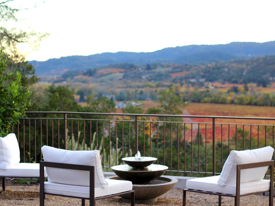 Lounge chairs on the deck facing a beautiful view in Dry Creek Valley