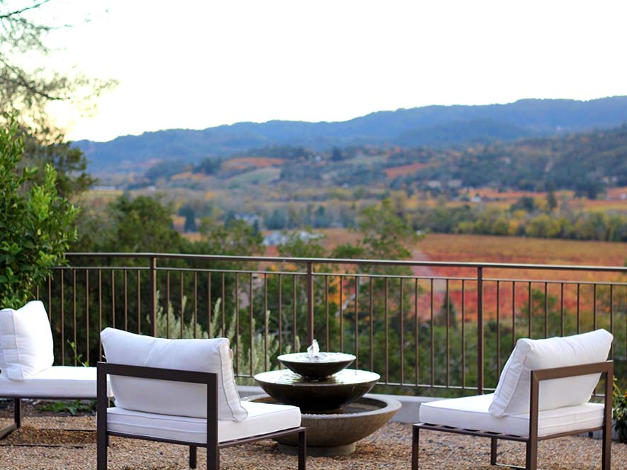 white chairs on patio overlooking dry creek valley