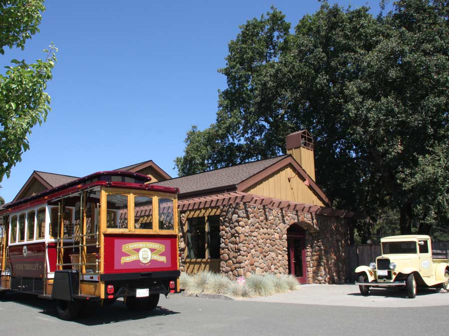 The Sonoma Valley Wine Trolley is parked outside of the stone winery at Mayo Family Winery in Sonoma County