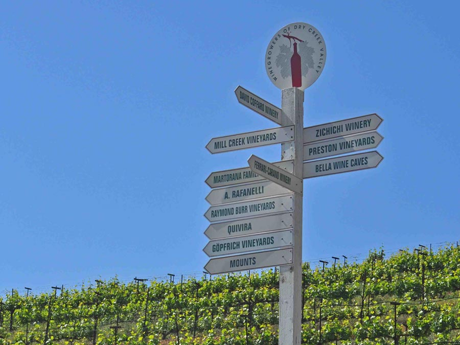 A sign post with the names of many wineries in Dry Creek Valley, AVA