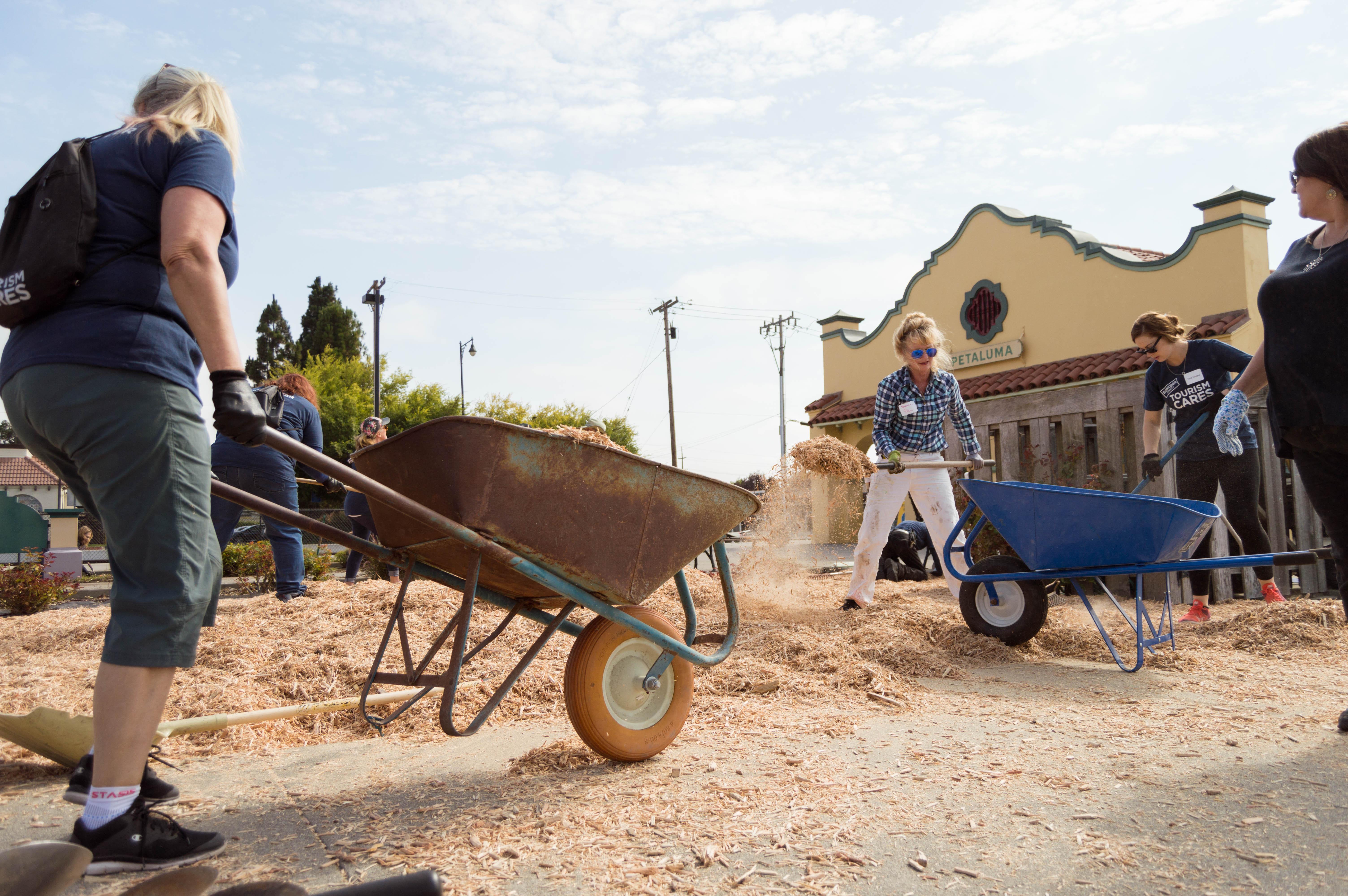 Volunteers work to beautify the Petaluma Visitors Center in Sonoma County, California