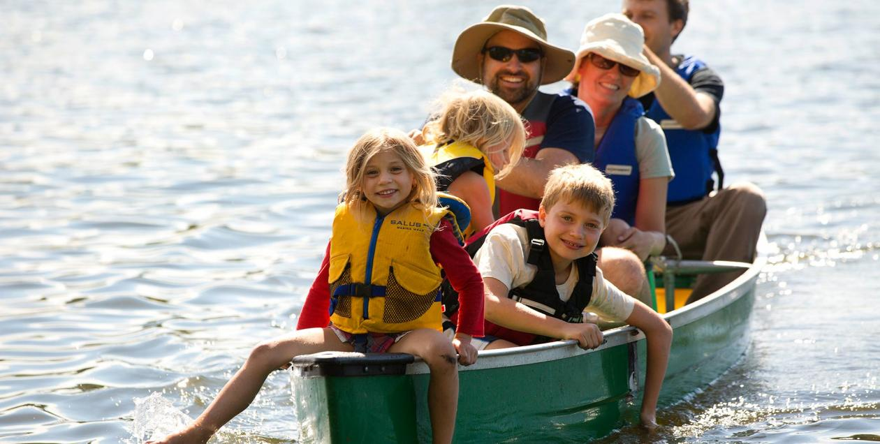 A family in a boat at Spring Lake Regional Park