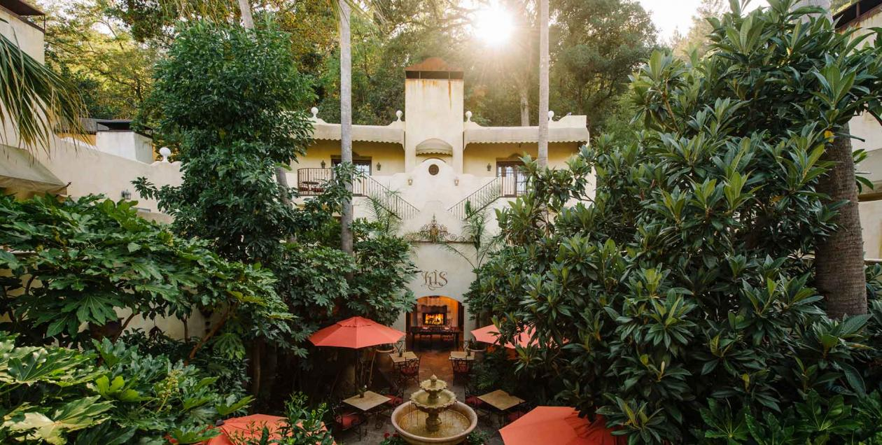 Ferns and vegetation decorate the courtyard of Kenwood Inn & Spa in Sonoma County