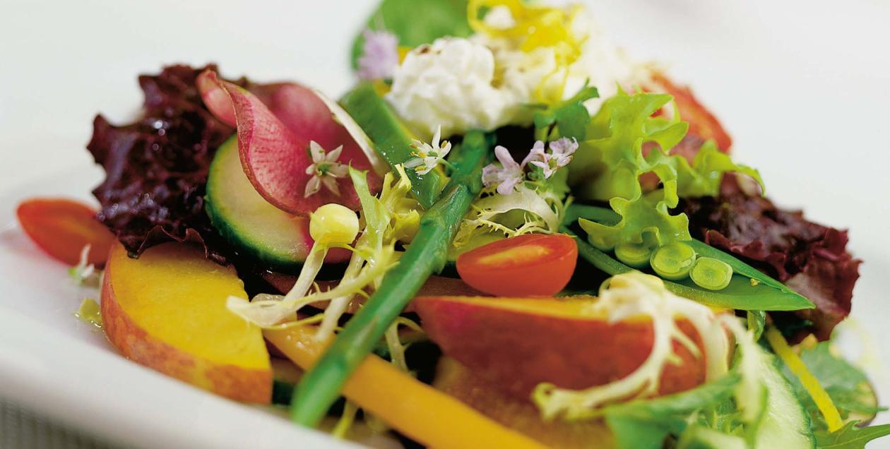 A salad of fresh vegetables and flowers