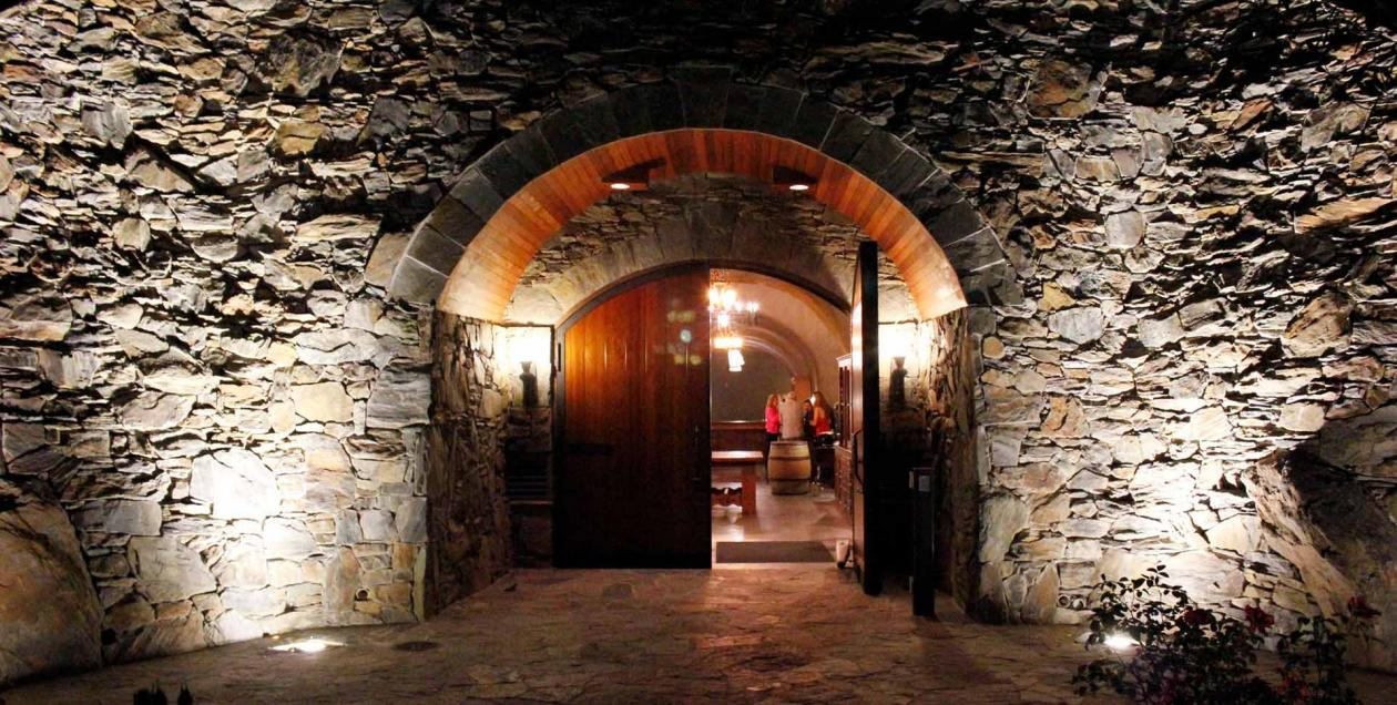 A stone cave opens up into a barrel room in Sonoma County, California