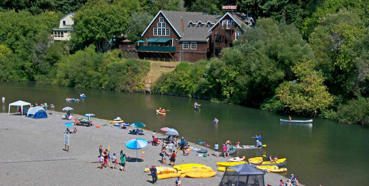 People enjoy swimming in the Russian River at Monte Rio Community Beach, Sonoma County