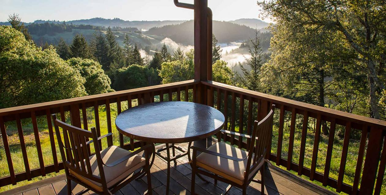 Two chairs overlook a mountain vista at Ratna Ling Retreat Center in Cazadero, Sonoma County, California