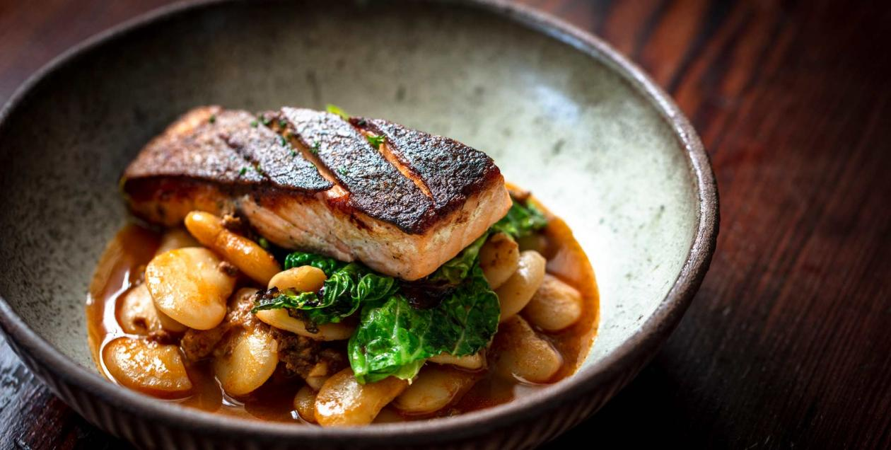 Blackened salmon on top of white beans and greens at Boon Eat + Drink in Sonoma County