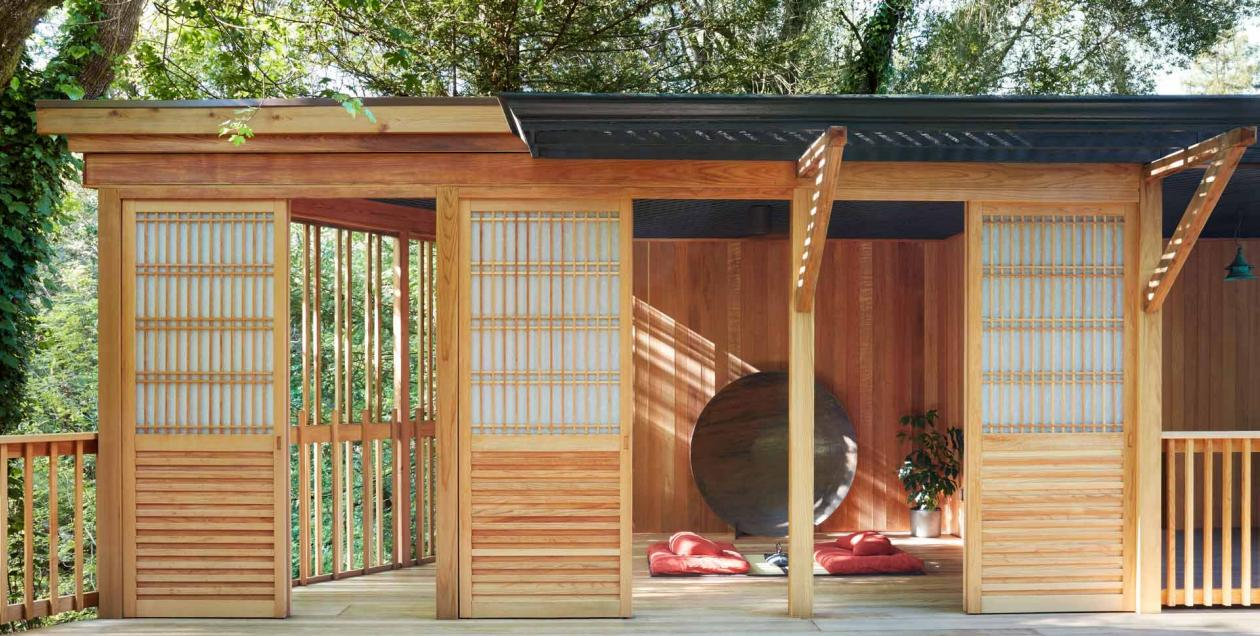 A pagoda for massage and meditation is surrounded by trees