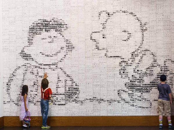 Interior shot of Charles M. Schulz Museum of a wall of small comics that make up a larger picture in Sonoma County