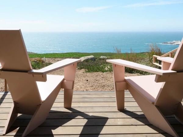 Two chairs look out to the Pacific Ocean at Timber Cove Resort, Jenner