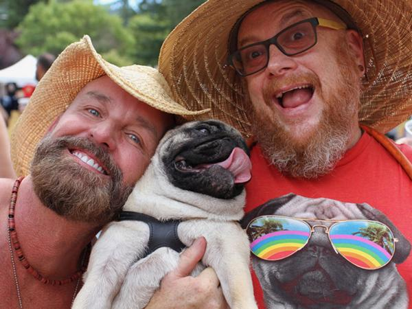 Image of two men and an adorable pug.