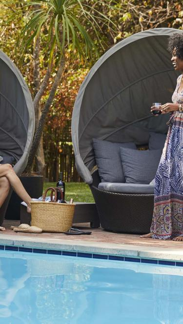 2 ladies lounging by the pool in Sonoma Valley