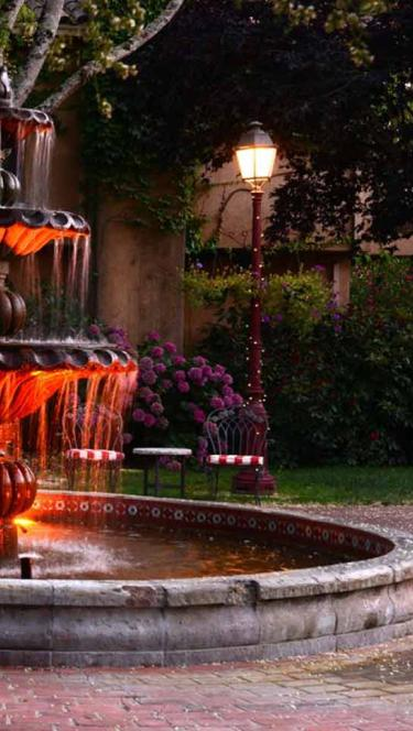 The fountain is illuminated at night at the Vinters Resort, Sonoma County
