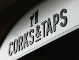 Corks & Taps sign