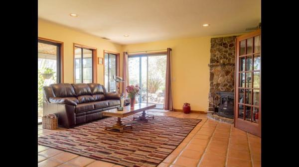 Family Room with Sleeper Sofa and Wood-Burning Fireplace Photo 9
