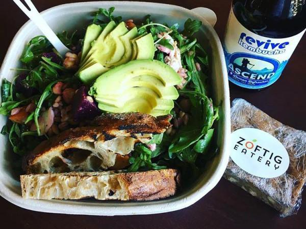 "The perfect lunch... - Zoftig ""build-your-own"" salad with grilled @goguettebread, @revivekombucha Lemon Refresher, and a house made white chocolate blondie. Photo"