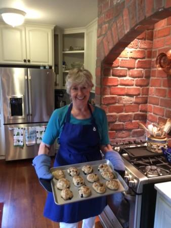 Sandy taking scones from oven. Photo 10